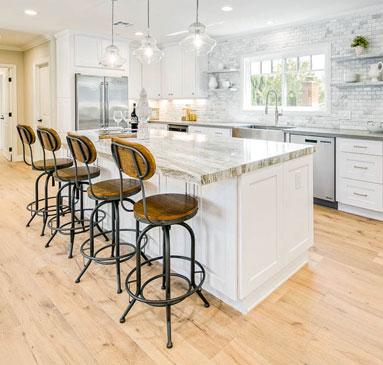 image showing bar stools at a kitchen counter island